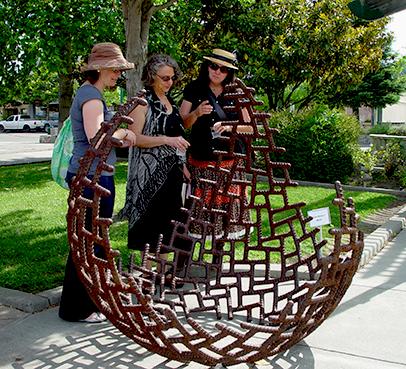 3 Women enjoying sculpture
