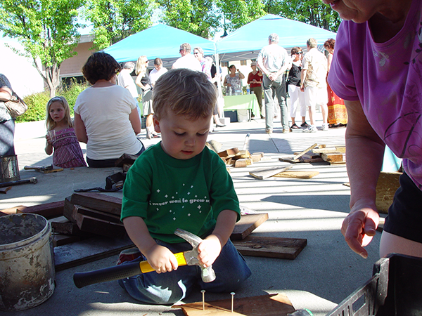 Child participating in sculpture event