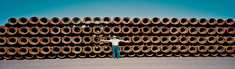 Joe in front of a stack of clay pipes
