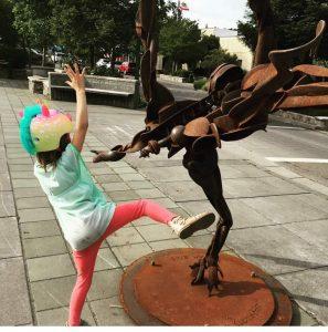 Girl posing like the sculpture